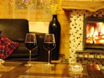 Enjoy a glass of wine by the fire in the long evenings of winter