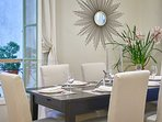 A dining table can comfortably accomodate 6 for dinner parties and casual entertaining.
