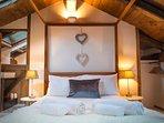 The beautiful ensuite master bedroom on the top floor