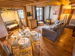 Wonderful open plan living, dining and kitchen area with rustic wood and exposed beams