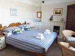 A lovely King size bed in the spacious bedroom with sea views