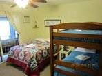 Bedroom with full size bed, twin bunk beds and A/C