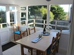 The dining area overlooks the garden and sundeck