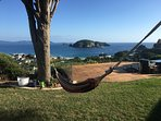 Chill out on the Hammock with one of the best Views in Hahei .