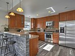 Bring all your favorite recipes to life in the fully equipped kitchen, featuring top-of-the-line stainless steel...