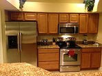 There are stainless steel appliances - stove, microwave, dishwasher and large fridge/freezer.