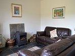 Comfy sofas & woodburner