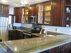 Full service Dream Cherry Kitchen with slab granite counters and stainless appliances.