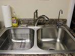 Kitchen sink also has an R/O water filtration spigot.