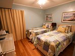 Guest bedroom may be configured from two twin beds to swing king upon request.