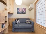 The comfy Western sofa makes this a good spot to relax with a drink and a book.