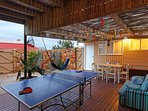 Entertainment deck:  outdoor shower, barbecue area, seating, alfresco dining, ping pong, darts