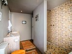 Main suite bathroom with shower and bath