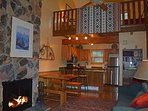 2 story stone wood burning fireplace with view to loft (firewood provided)