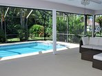 Covered patio with screen enclosed heated pool