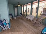 Additional view of the wrap around porch. Plenty of extra beach chairs to place throughout  the deck space or take...
