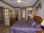 Main level king room with attached full bath includes Jacuzzi tub.  Fireplace also in this grand room.