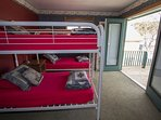 Bunk room on the 2nd floor has 2 bunks sleeping 4 with an additional private space and more sleeping.