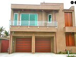 Front, 2 car garage, balcony with ocean view,