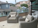 Rear balcony. stairs to roof deck with ocean view, overlooking private backyard with BBQ