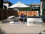 Private back yard with two sitting areas and BBQ