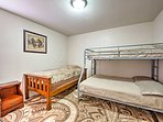 The 3rd bedroom has a twin-over-queen-sized bunk bed and additional twin bed.