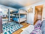 This room has 2 Full sized beds bunk bed style, One fold down Bluetooth couch  and two singles.