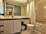 The full bathroom features towels, washcloths, hand towels, hairdryer, soap and shampoo