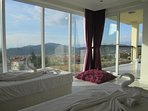 Twin Bedroom with stunning views over valley with mountain backdrop