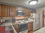 The kitchen boasts full-sized appliances.