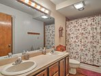 Take a shower or bath and unpack your toiletries in the second bathroom.