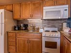 Fully equipped kitchen with granite counter tops and plenty of cabinet space
