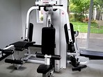 Renovated gym has new weight and abdominal machines.