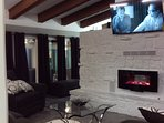 family room with fireplace with 60in tv,& surround sound