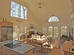 Inside the main roof, a vaulted ceiling and oversized windows fill the modern living room with natural light