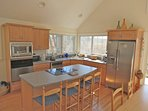 The fully equipped kitchen has all the essentials and four high-boy chairs for casual meals and lively conversation.