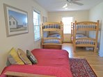 The first floor bedroom has two sets of bunks... plus a full sized futon. AWindow AC unit located here.
