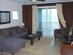 Living room and balcony doors.  That is the Pacific Ocean in the door view !!