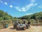 Deck with comfy seating, bbq and sun lounger.