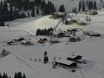 Aerial view of chalet with Hotel Neubergerhof in the distance.