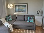 Take a rejuvenating nap on this plush couch in the living room.
