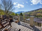 Beautiful Vail Mountain views off main level deck, with plenty of seating and fire pit.