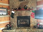 Gas log fireplace  decorated for the holidays