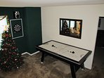 Air Hockey Table in the Upstairs Lounge