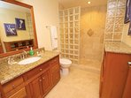 Guest (hall) bathroom with luxurious glass block and travertine shower!