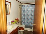 Main Bathroom, centrally located by bedrooms and living area.