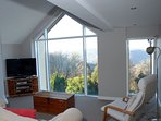 The first floor sitting/games room affords spectacular views over the Wye Valley