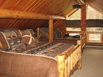 The upstairs loft has one queen size bed and another full size bed. Plenty of room upstairs.