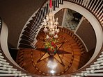 The Spiral Staircase with a hanging Chandiller and the floor medillion handmade from 7 MD hardwoods.