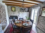 Beamed ceiling, stone walls and oak table for perfect country cottage dining
